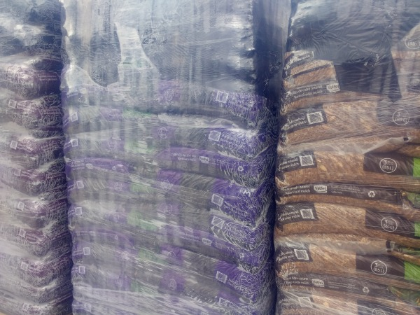 several colors of mulch in bags